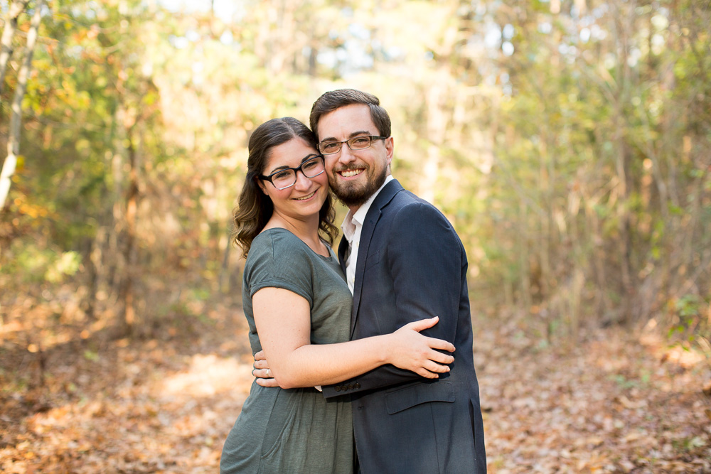 Happy engaged couple on the trails at Crockett Park during fall engagement session