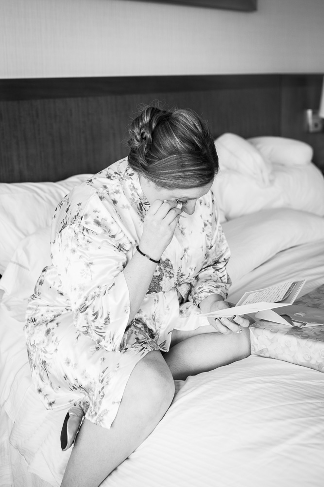 Bride crying while reading a heartfelt letter from the groom before their wedding | Candid Northern Virginia Wedding Photos