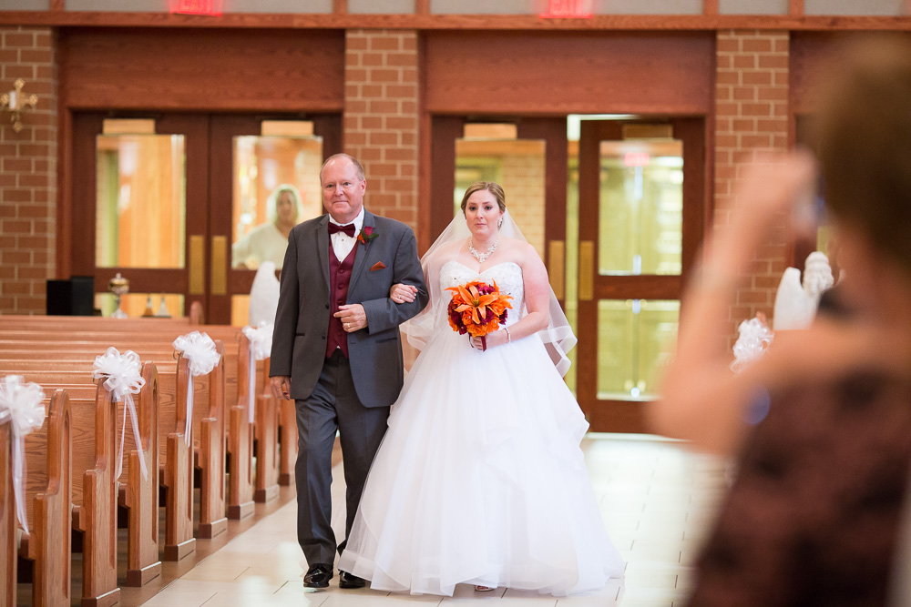 Bride and her father walking down the aisle at Saint Theresa Church in Northern Virginia | Ashburn Wedding Ceremony Venue