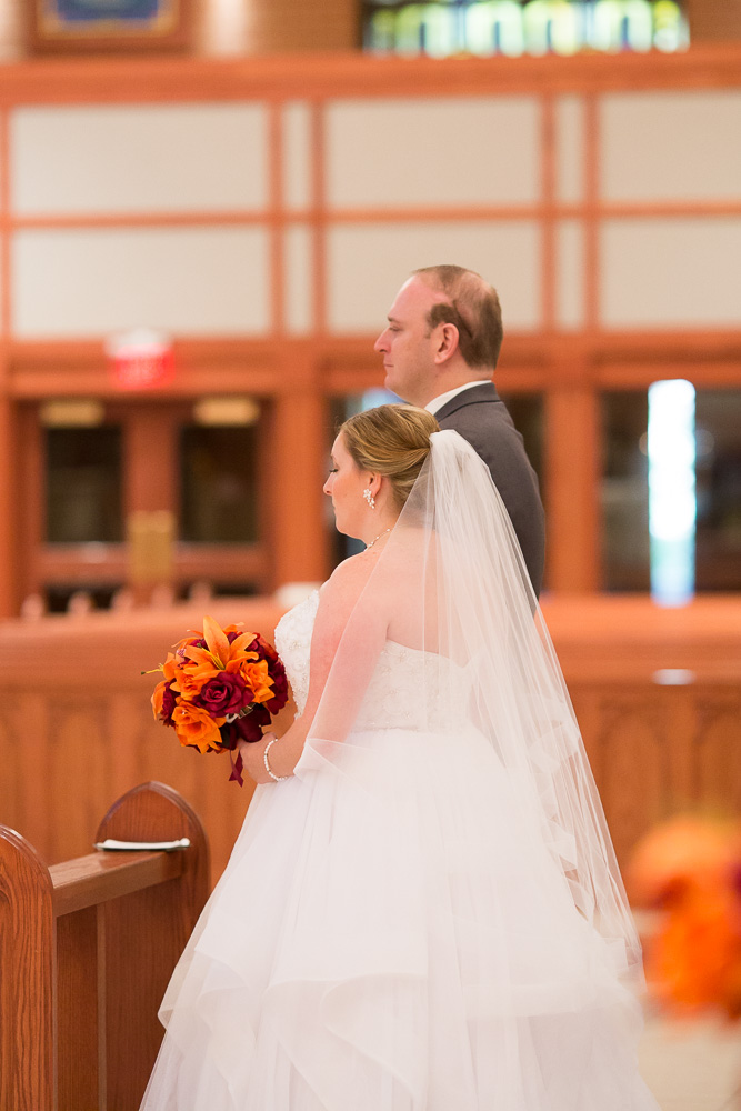 Bride and groom at the altar | Catholic Churches for Wedding Ceremony in Northern Virginia