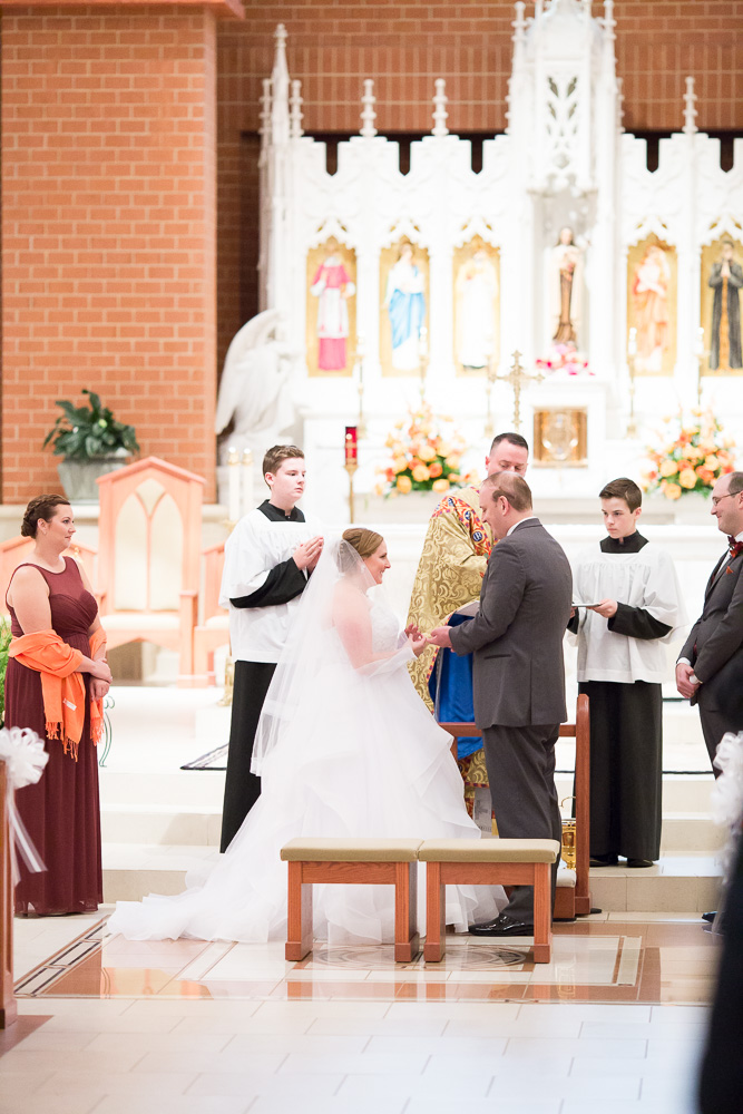 Exchanging rings during the wedding at St. Theresa's Church | Northern Virginia Wedding Photography