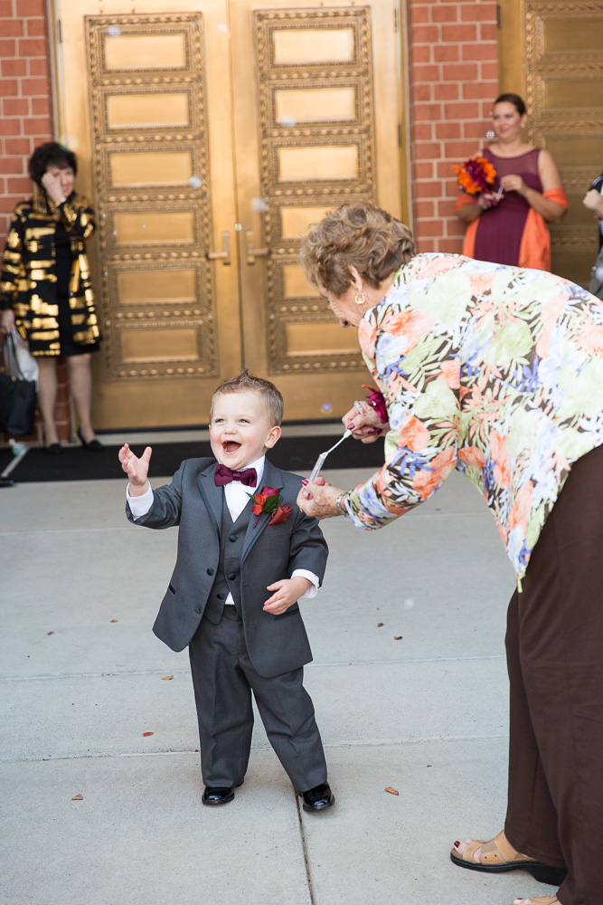Ring bearer playing with bubbles after the wedding ceremony | Ashburn Virginia Wedding