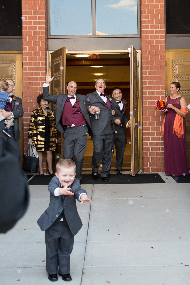 Funny bubble exit photo at St. Theresa Parish in Northern Virginia | Northern Virginia Candid Wedding Photographer