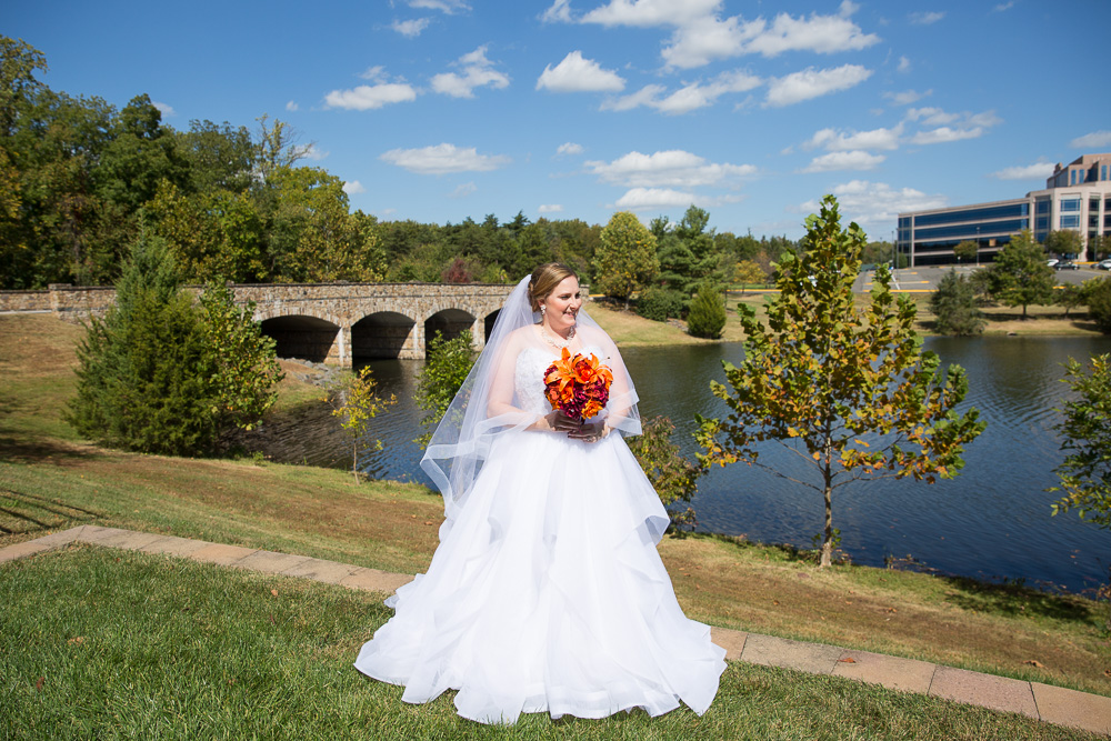 Bride posing in front of the lake at the Westin Washington Dulles in Herndon, Virginia