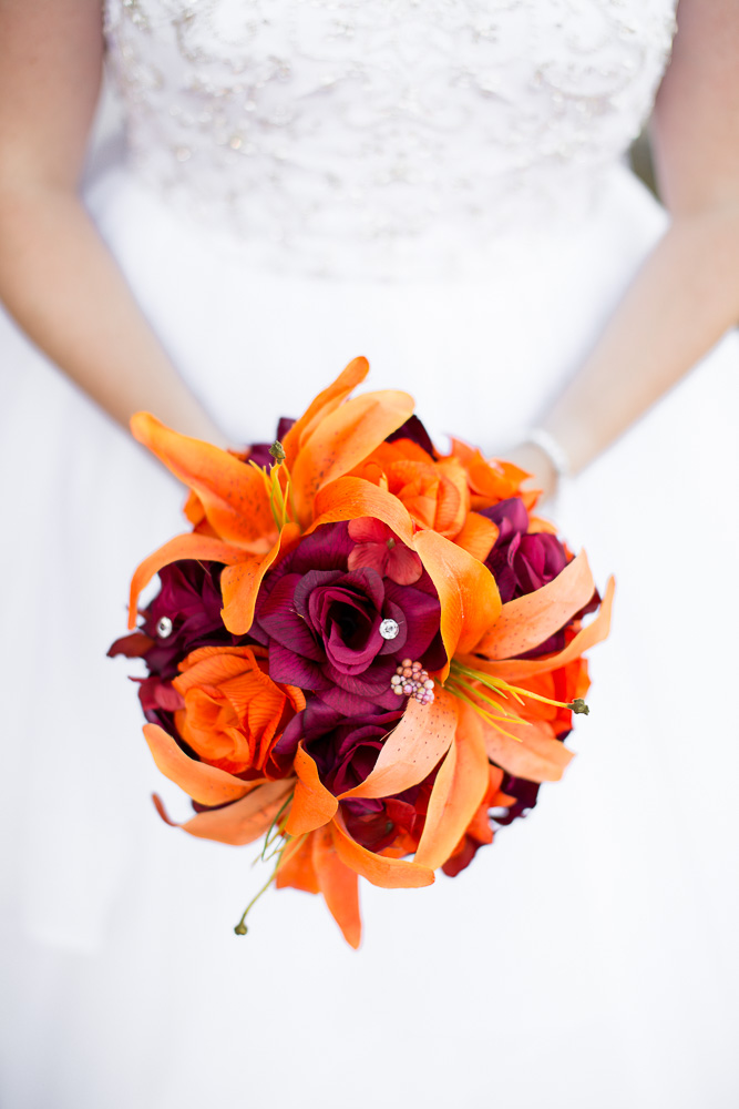 Orange and burgundy bridal bouquet from Lily of Angeles