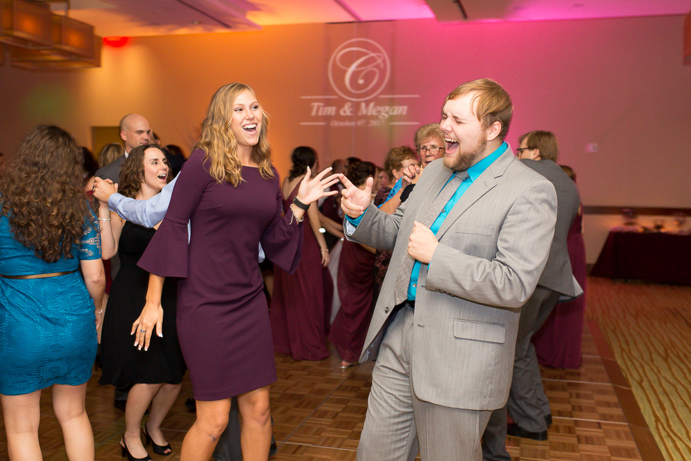 Candid dance floor picture of wedding guests at the Westin Washington Dulles Airport Hotel | Megan Rei Photography
