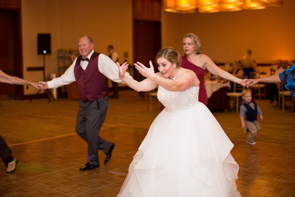 Candid picture of the bride on the dance floor during the bridal dance