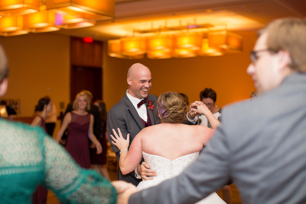 Bride dancing with one of the groomsmen during the wedding reception | Best Wedding Venues in Northern Virginia | Westin Washington Dulles