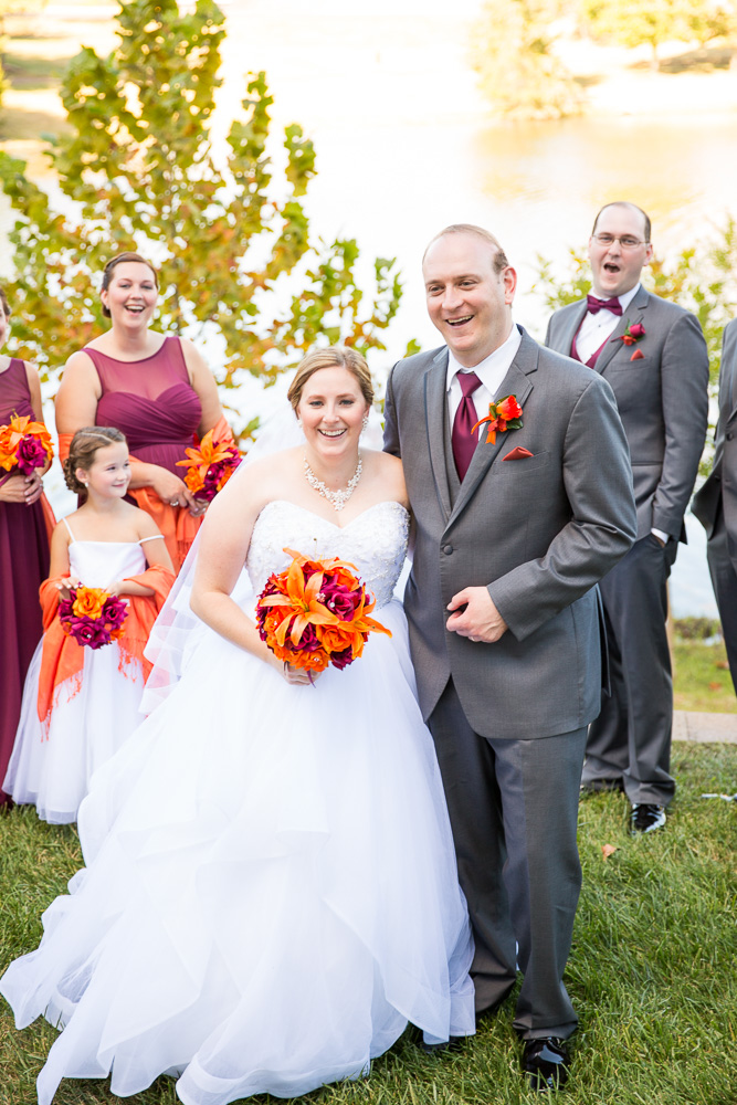 Candid photo of bride and groom with the wedding party | Herndon, Virginia Wedding
