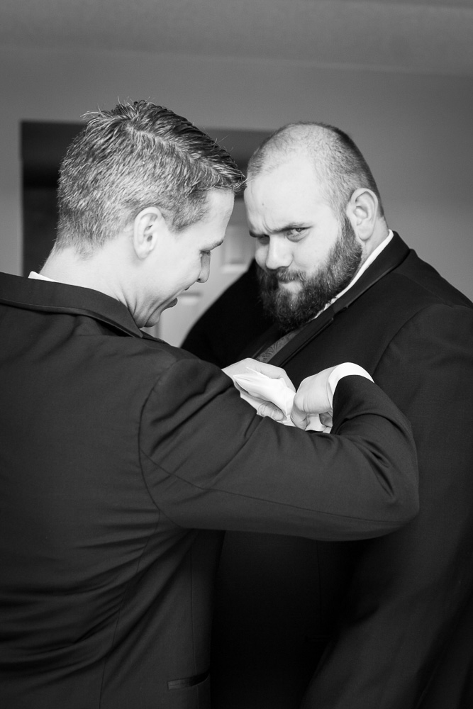 Funny photo of groom getting ready in Richmond, Virginia