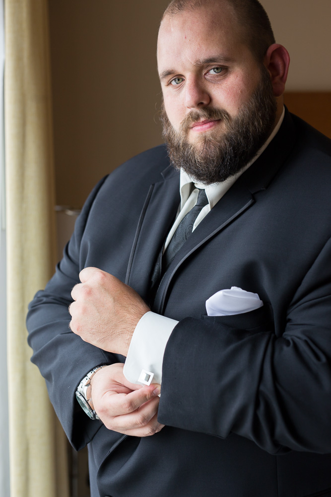 Groom portrait, adjusting his cuff links | Richmond VA Wedding