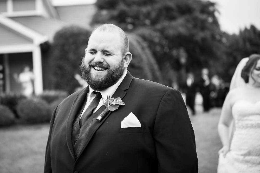 Smiling groom as he waits to see his bride for the first time | Documentary Wedding Photography in Richmond, Virginia