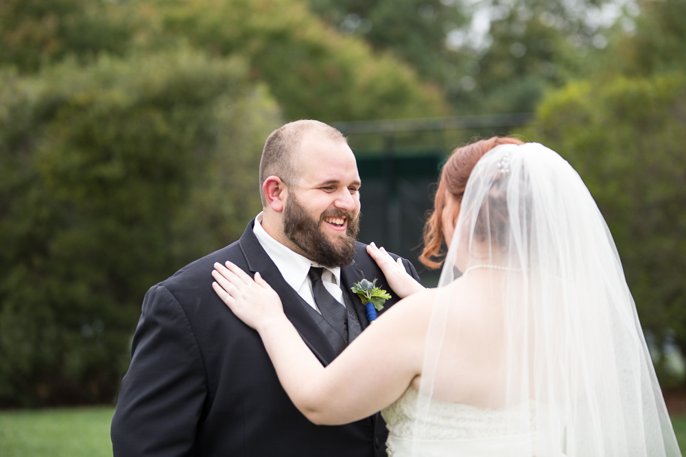 The First Look as bride and groom see each other for the first time at Fox Hall Clubhouse, Richmond