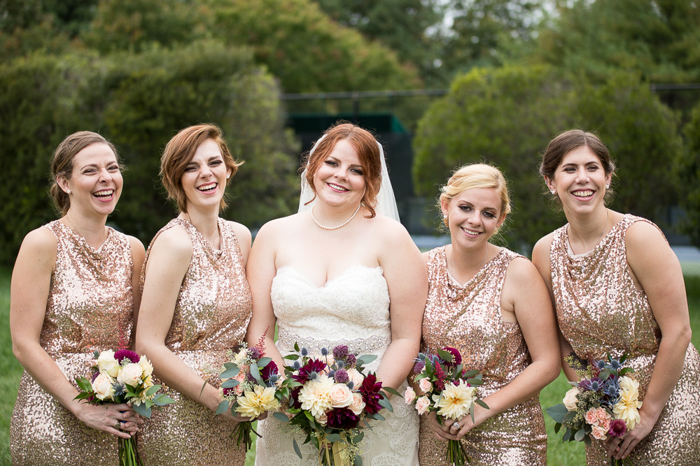 Bridal party laughing while taking pictures at Fox Hall Clubhouse in Richmond, VA