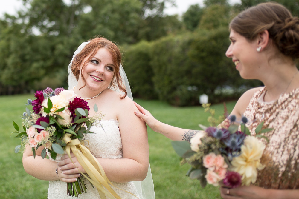 Bride looking over her shoulder at her bridesmaid