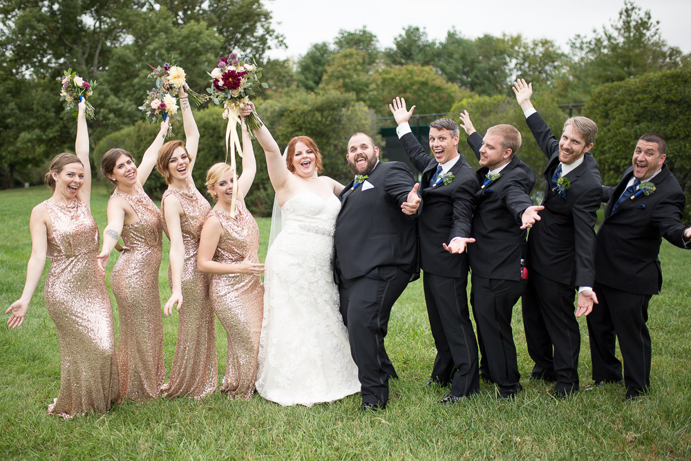 Fun wedding party posing at the Fox Hall Clubhouse venue in Henrico