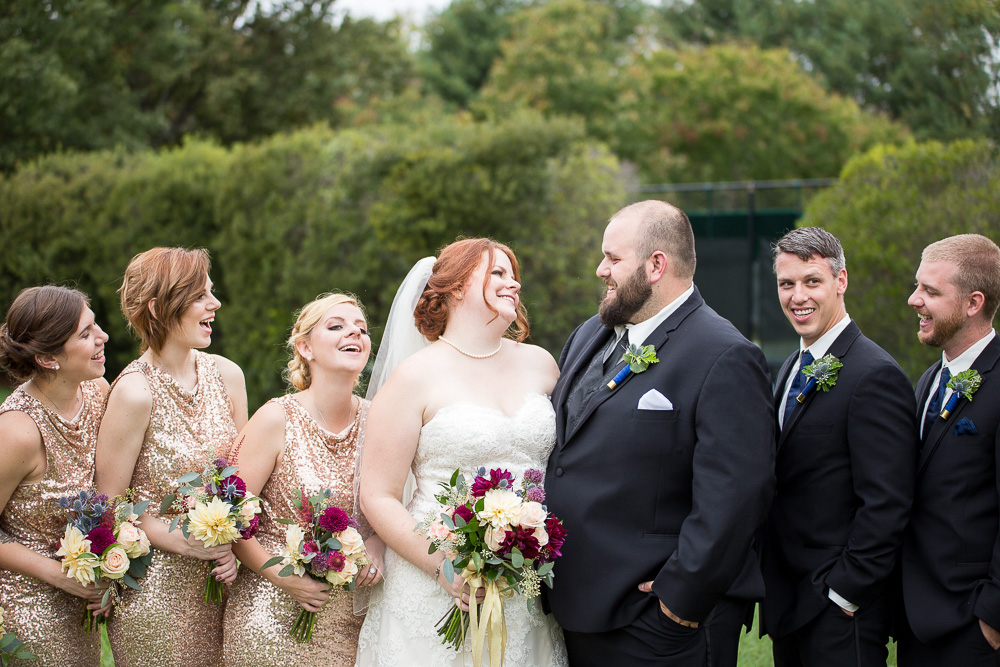 Wedding party smiling and laughing at Fox Hall Clubhouse