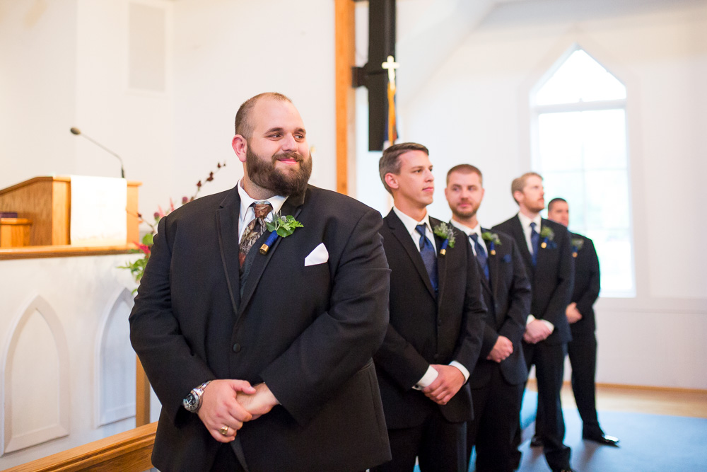 Groom watching bride come down the aisle at Shady Grove United Methodist Church in Short Pump, VA