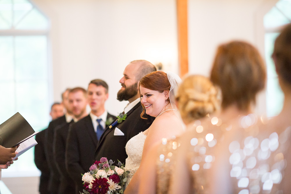 Candid photo of bride and groom during wedding ceremony at  Shady Grove UMC in Short Pump, Virginia