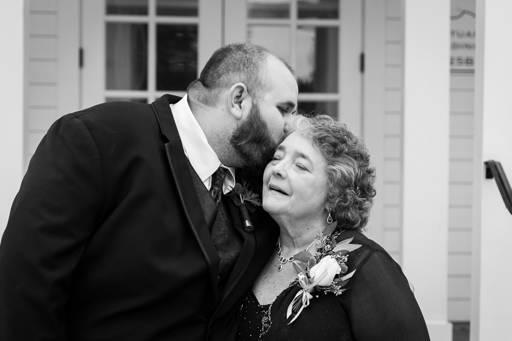 Groom giving his mother a kiss
