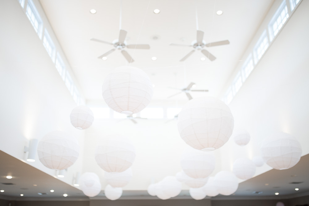 White paper lanterns hanging from ceiling at Fox Hall Swim and Racquet Club wedding venue in Richmond