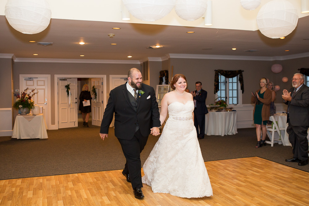 Bride and groom making their grand entrance into their wedding reception
