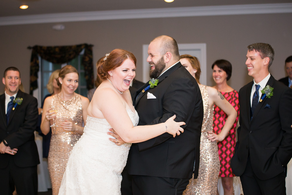 Candid photo of husband and wife laughing during their first dance