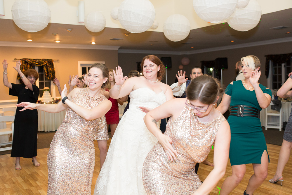 Bride and guests having fun on the dance floor at wedding at Fox Hall Swim and Racquet Club