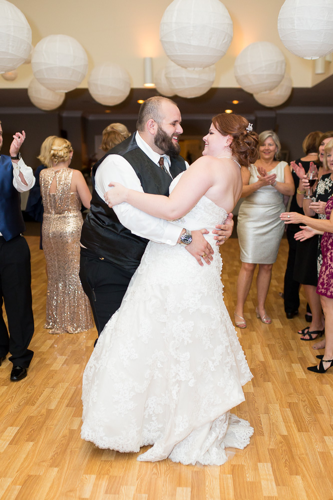 Bride and groom laughing on the dance floor during Richmond, VA wedding