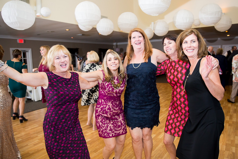 Wedding guests having fun at reception at Fox Hall Clubhouse in Henrico, VA