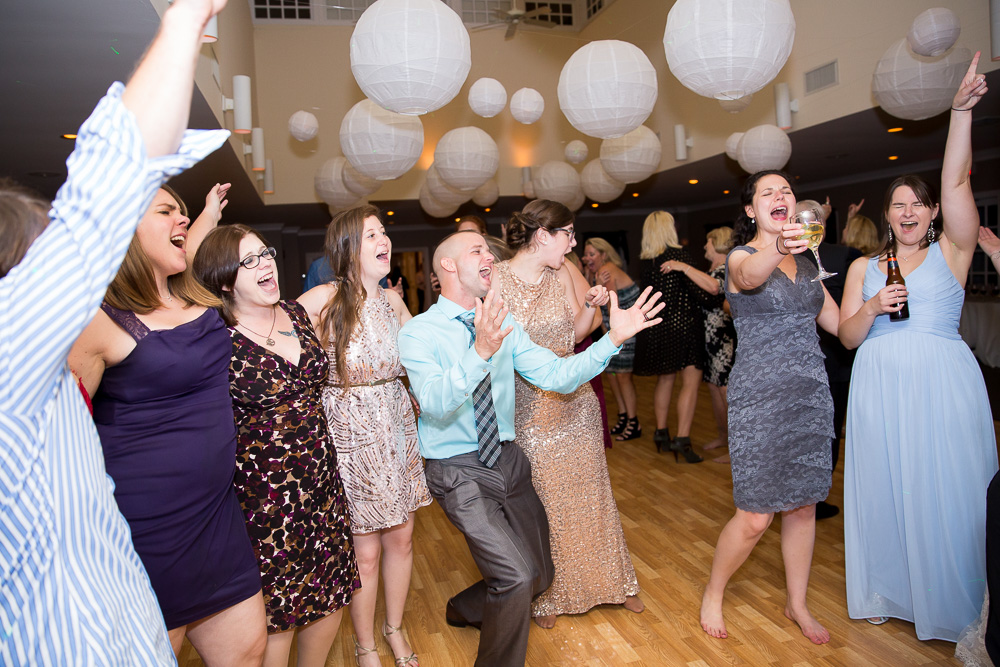 Candid picture of wedding guests dancing during wedding reception in Richmond Virginia