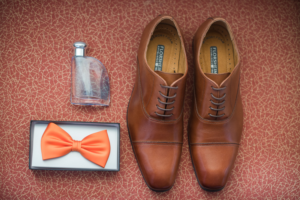 Groom's details - shoes, bowtie, and cologne