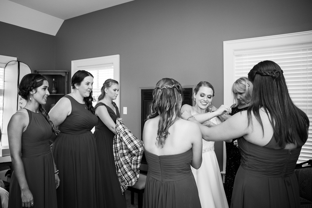 Putting on the wedding dress | Getting ready room at Mountain Run Winery | Documentary Wedding Photography