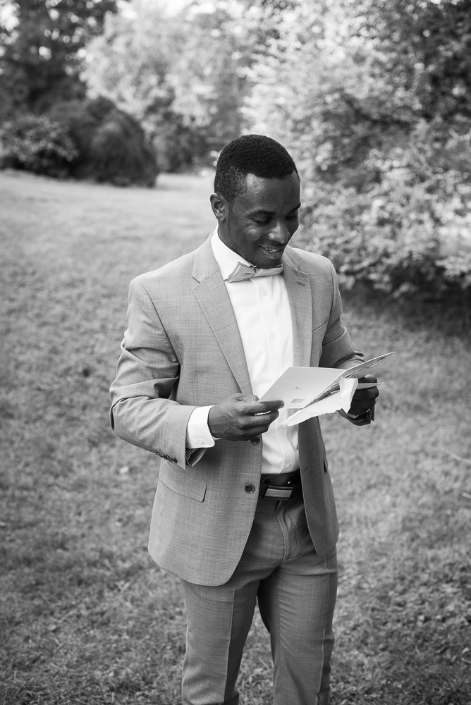 Groom opening a letter from the bride before the wedding ceremony