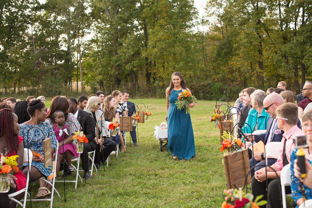 Bridesmaid walking down the aisle with Cody, the Dog of Honor, in tow | Culpeper, Virginia Wedding