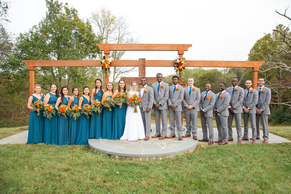 Wedding party photo at the outdoor ceremony site at Mountain Run Winery | Rustic wedding venue in Culpeper, Virginia