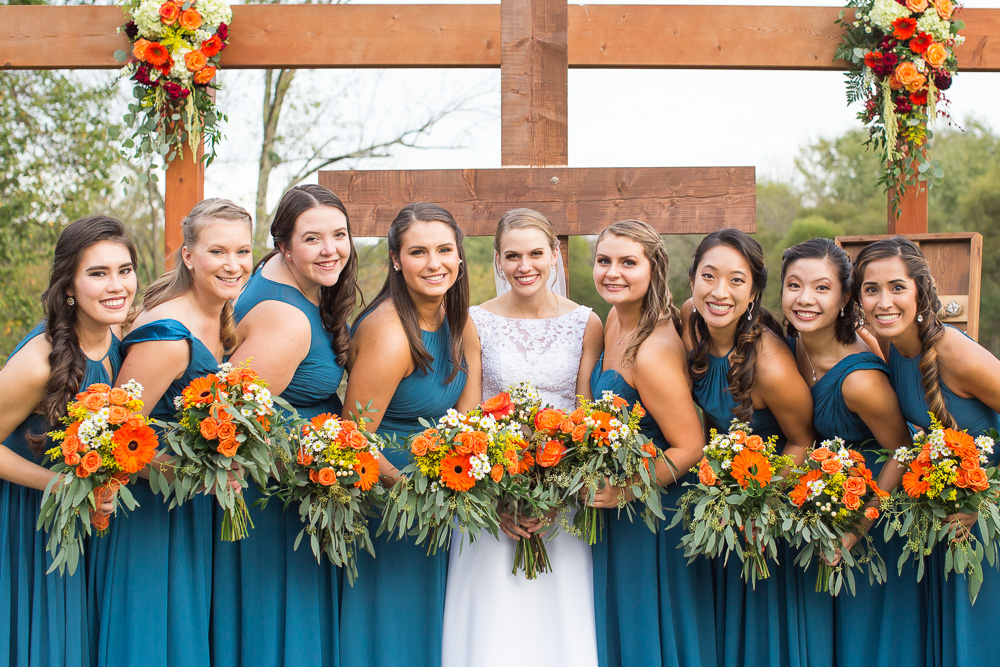 Bride and her bridesmaids | Teal and orange wedding colors