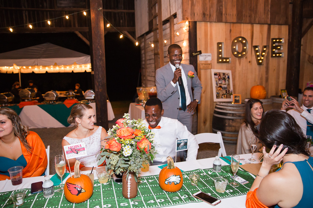 Best man giving his toast at a football-themed wedding in Culpeper, Virginia