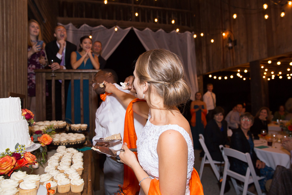 Cutting the wedding cake from Eloise's Pastries | Barn Wedding in Culpeper, Virginia