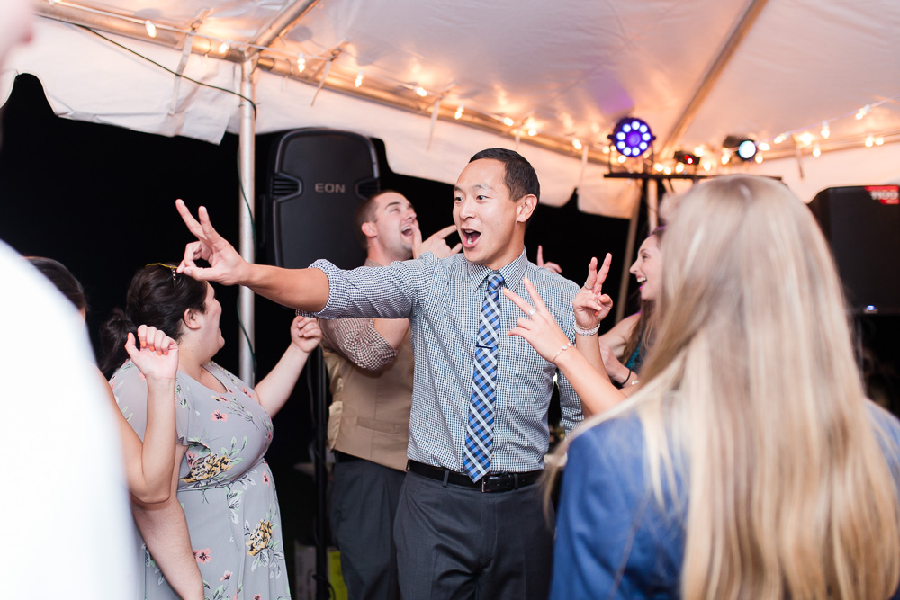 Fun dance floor photo under the tent at Mountain Run Winery | Candid Wedding Photography in Culpeper