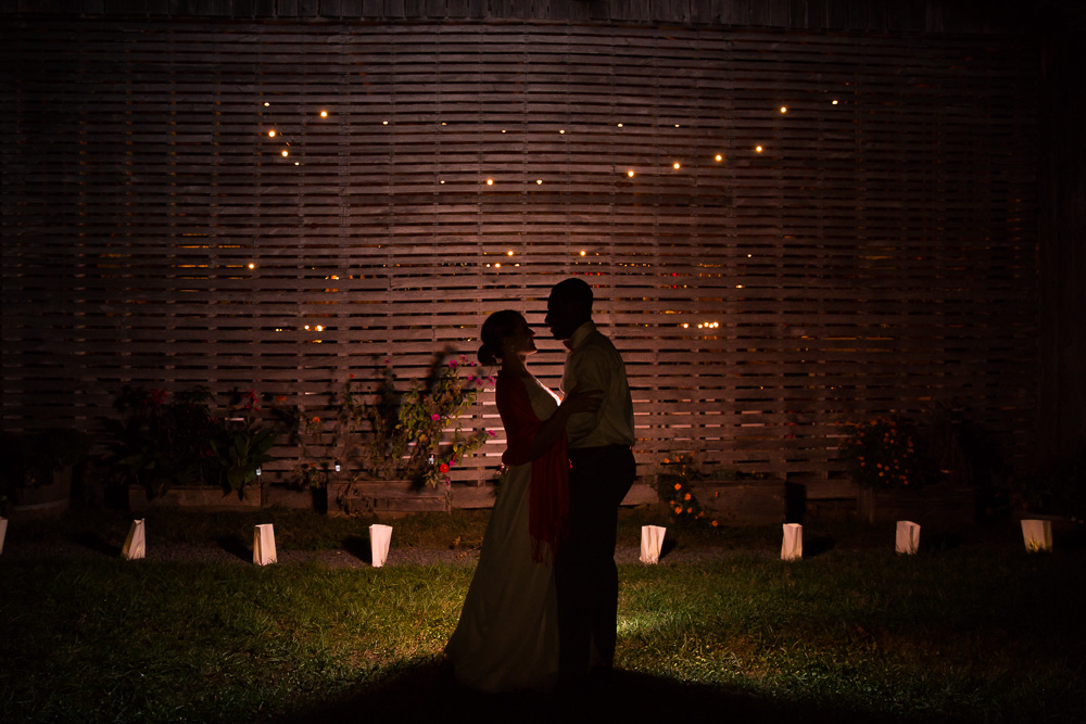 Silhouette photo of the bride and groom outside of the barn at Mountain Run Winery | Best Barn Wedding Venues in Northern Virginia