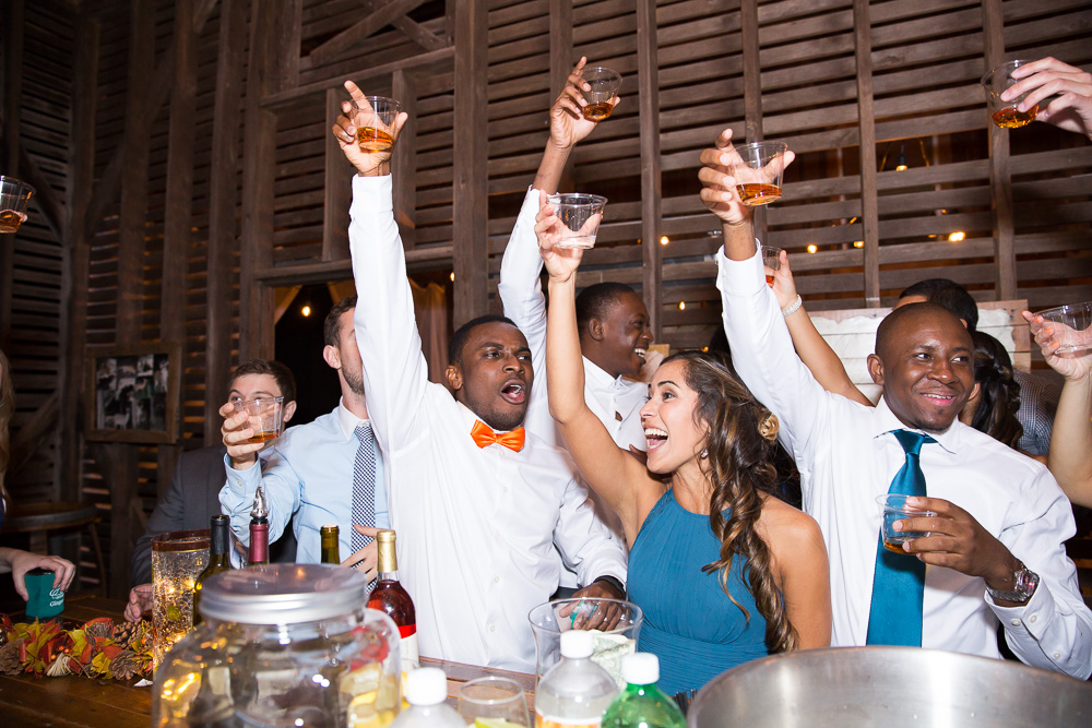 Taking shots at the bar at Mountain Run Winery | Best Barn Wedding Venues in Culpeper, Virginia | Candid Culpeper Photographer