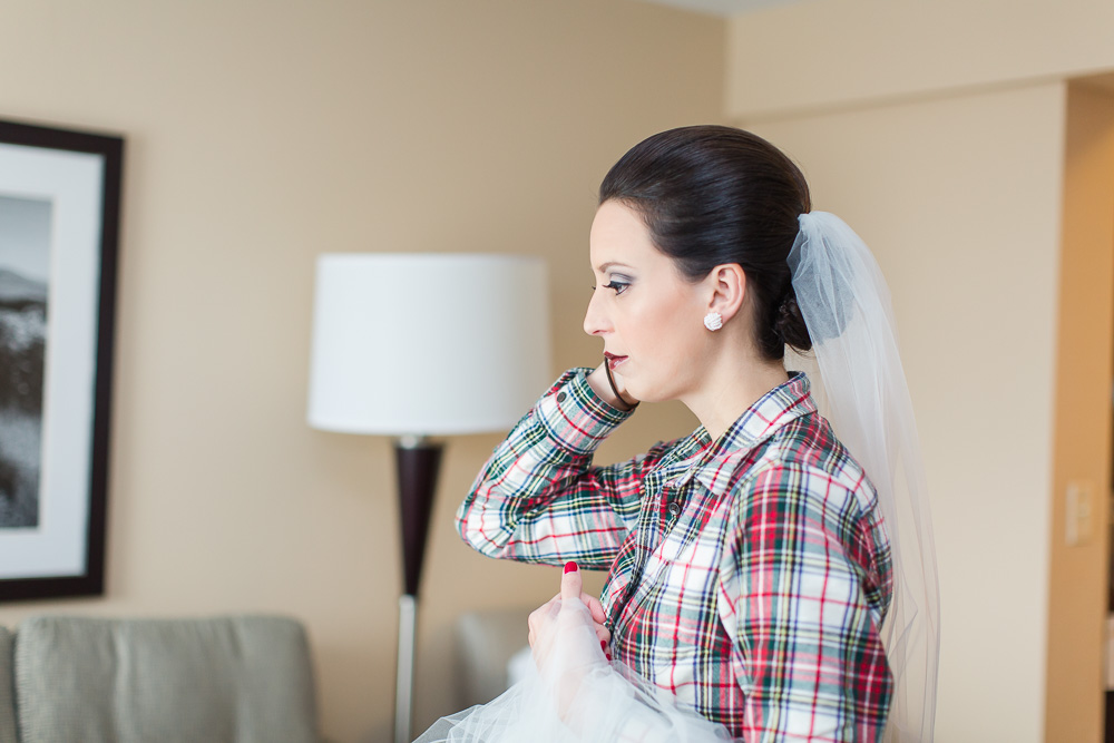 Bride getting ready for the wedding day at The Strathallan Hotel | Rochester, NY
