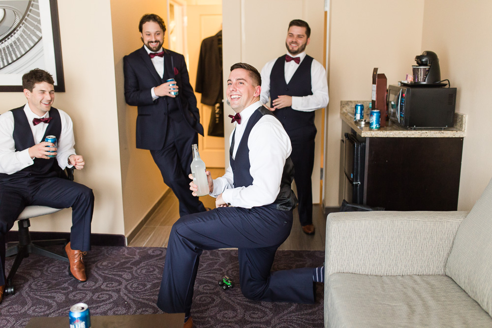 Candid photo of groomsmen hanging out before the wedding ceremony | Strathallan