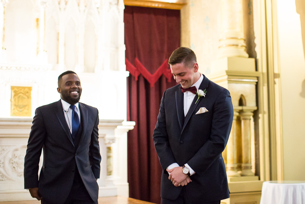 Groom anxiously waiting at the altar | Rochester Candid Wedding Photography