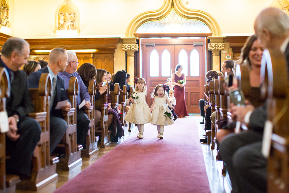 Flower girls coming down the aisle at Chapel Hill | Rochester NY Wedding Venue