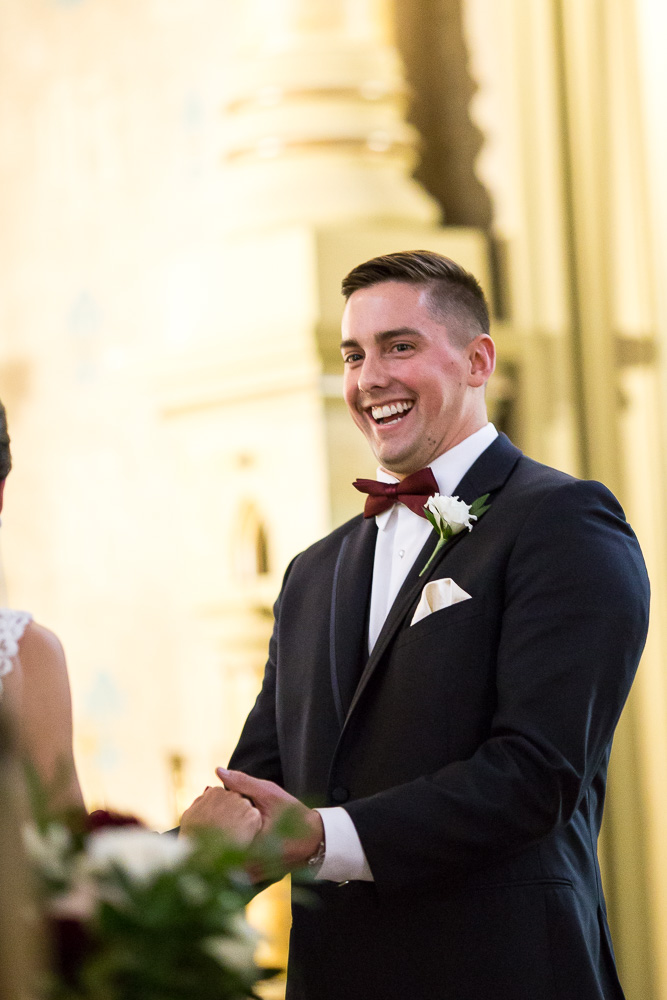 Candid photo of laughing groom | Chapel Hill Weddings | Best Places for Wedding Ceremony in Rochester, New York