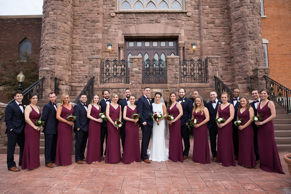 Full wedding party photo in of the church | Chapel Hill Wedding Photography | Navy and burgundy bridal party