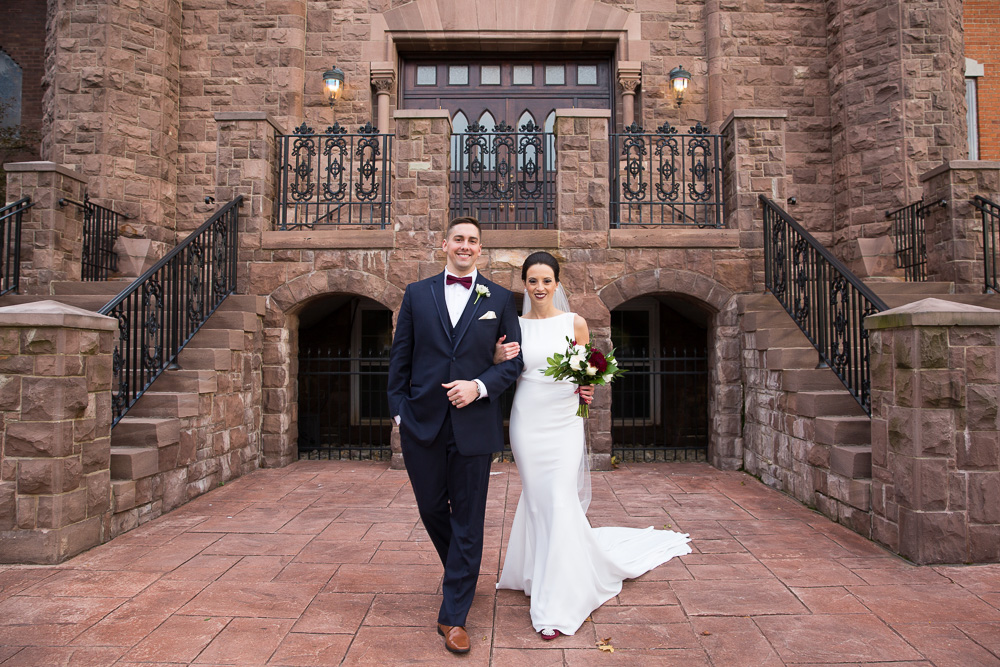 Bride and groom portrait in front of Chapel Hill