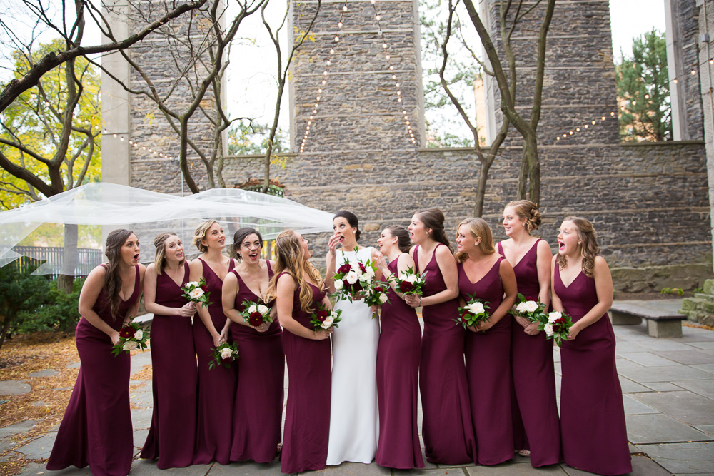 Funny wedding photo of veil caught in the wind | Candid Wedding Photographer in Rochester NY | Megan Rei Photography | St. Joseph's Park